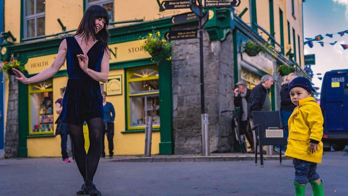 Irish dancer and child in Galway