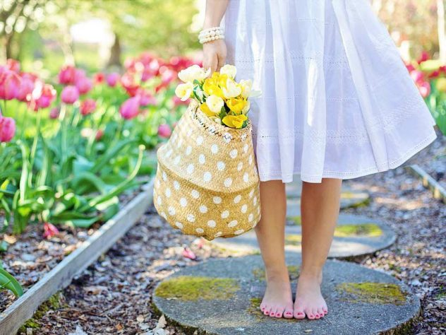 Lady-in-garden-of-flowers.