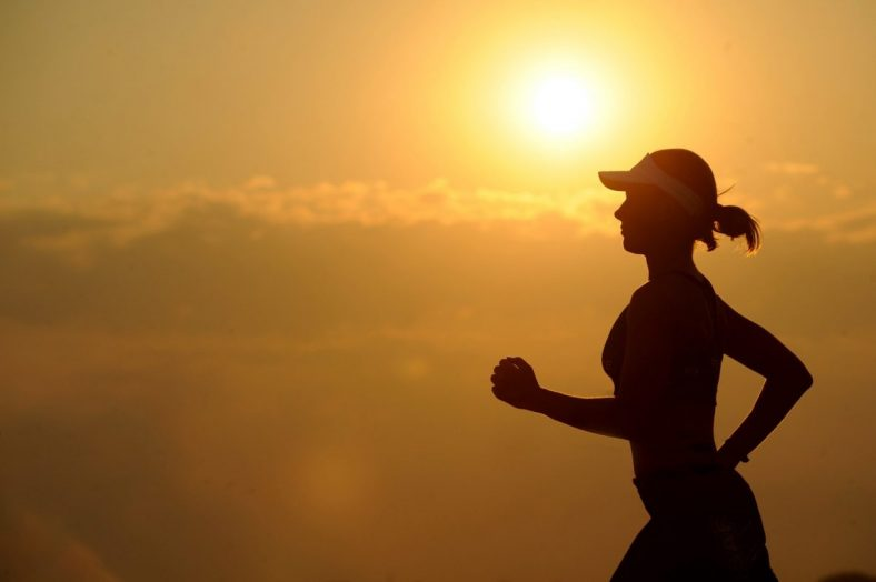 Silhouette of woman running - Pexels