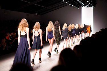 Models walking on catwalk