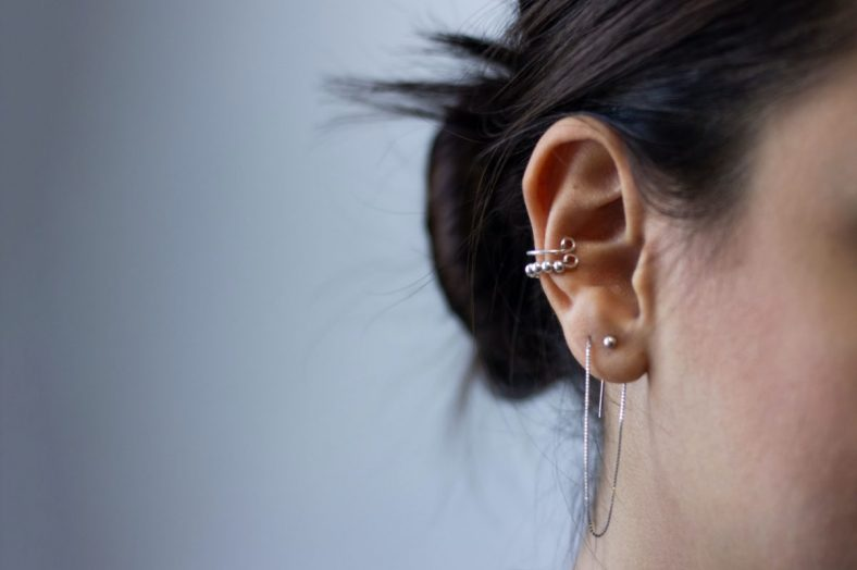 Lady with curated ear piercings