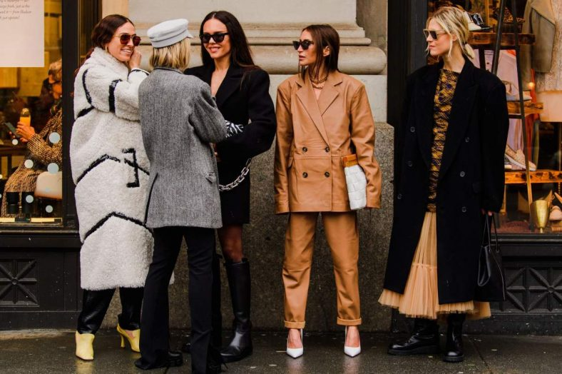 Feature Image: group of five women outside shop