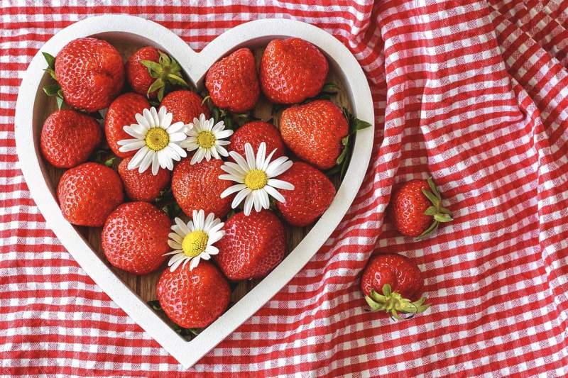 Strawberries in heart shaped bowl