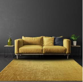 yellow couch and rug with grey walls